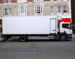 White delivery transportation vehicle parked on street