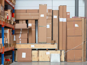 Cardboard boxes with equipment in distribution warehouse